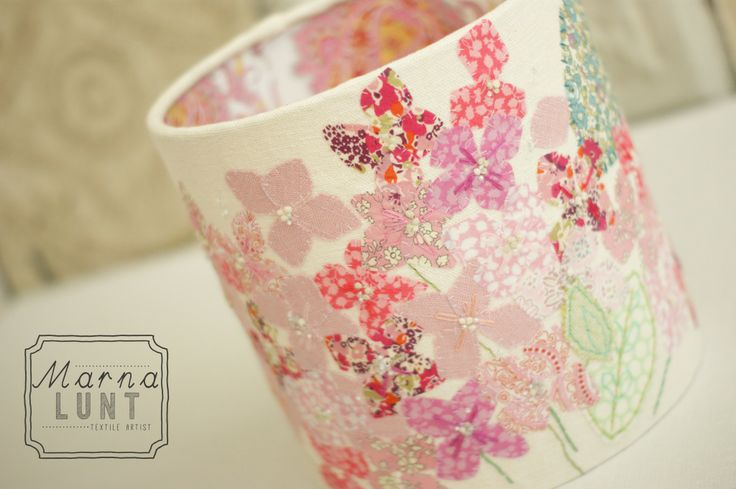 Hand embroidered lampshade by Marna Lunt lined with liberty tana lawn. Www.marnalunt.co.uk