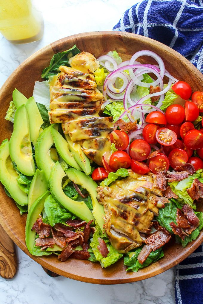 Honey Mustard Chicken Salad with bacon, avocado, sliced red onion, and sliced tomatoes topped with a three ingredient honey mustard dressing. Creamy, tangy and so addictive! Paleo