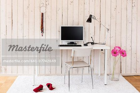 Simple home office with personal computer and personal stuff – Image © Masterfile.com: Creative Stock Photos, Vectors and Illustrations for Web, Mobile and Print