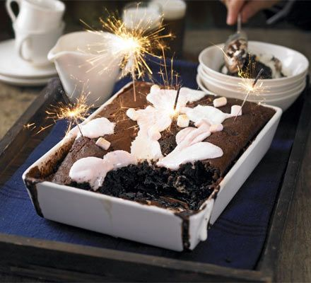 Sticky chocolate pudding with marshmallows - self-raising flour, baking powder, cocoa powder, milk, eggs, vanilla extract, single cream, light muscovado sugar, marshmallows