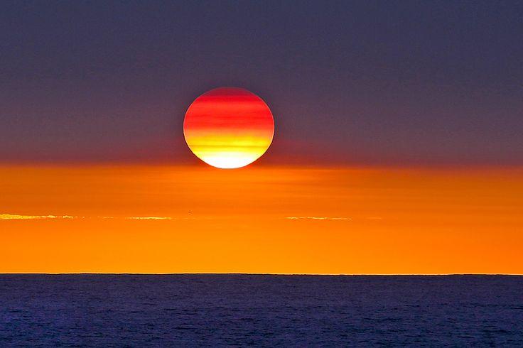 Sunset at Afulu on the west-coast of North Nias Regency. Nias Island, Indonesia. Photo by Bjorn Svensson. www.northniastourism.com