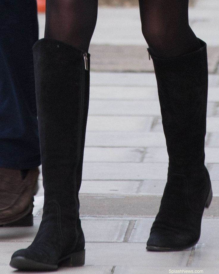 Kate leaving Hospital wearing her Charge It boots by Russell and Bromley. Closeup Jeff Moore Splash