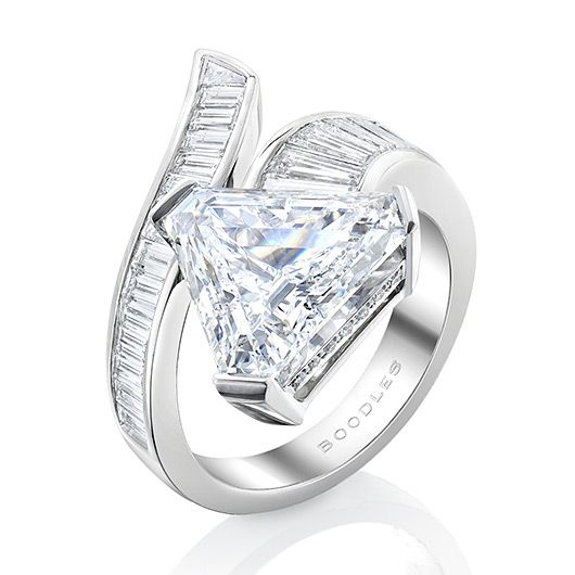 Boodles. Gemini Trilliant. A gleaming D colour Trilliant diamond of over 5 carats, with a trail of twinkling tapered baguettes. All specifically cut for this exceptional piece, and beautifully crafted in platinum.
