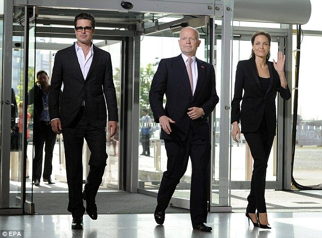 Unlikely trio: Brad Pitt (left), William Hague (centre) and Angelina Jolie (right) arrive ...
