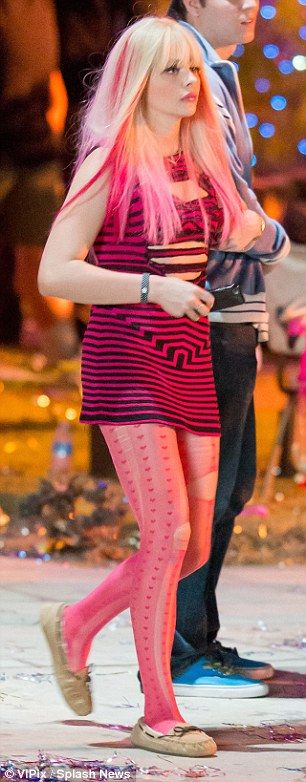 Teeny! The dress, which conceded just inches below her bottom, was teamed with a pair of ripped pink tights, while her locks were concealed beneath a long blonde wig with bright pink tips