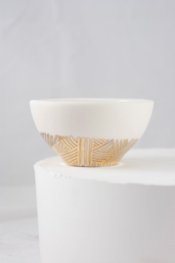 This little porcelain bowl is the perfect bedside spot for rings and jewels.