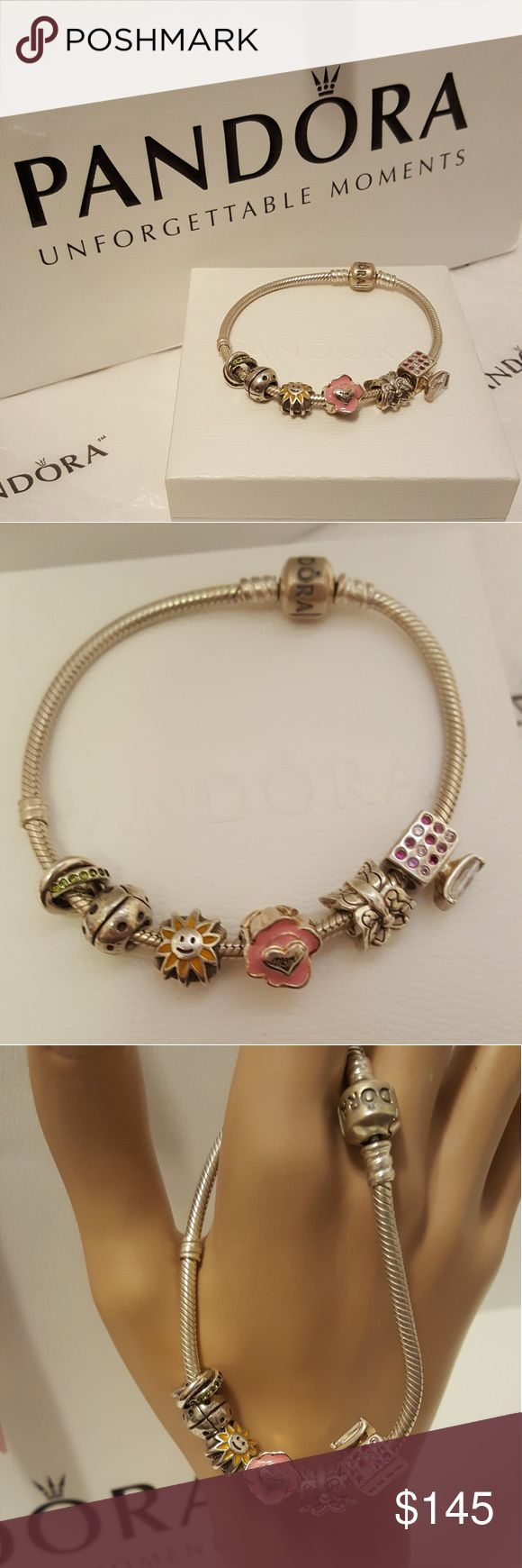 Authentic Pandora 7.75 bracelet with 6 charms. Pre loved bracelet dedicated to mom. Bracelet comes with mixed pandora and chamilia charms. All charms are marked 925 or S925. Comes with a Pandora bracelet box and bag. Pandora offers free cleanings for life on their products. I am open to trades. Looking for a Tory Burch bag. Pandora Jewelry Bracelets