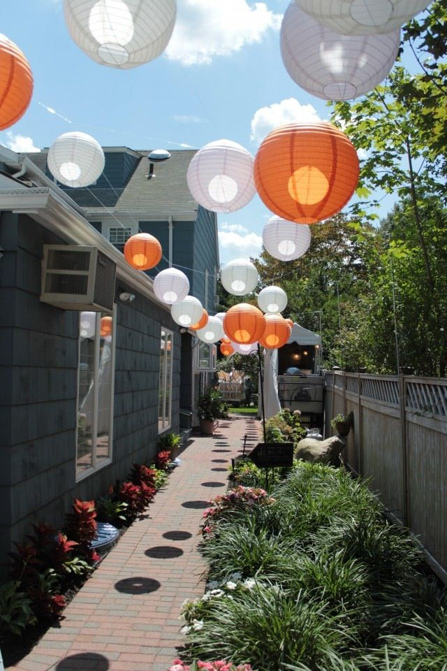 Paper lanterns on fishing wire transform a backyard