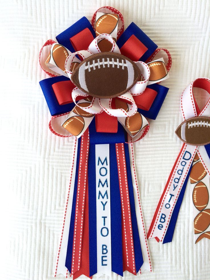 All American Sports Football Baby Shower Corsage Set. This is a Mommy and Daddy set created for a football themed shower.  Find me at iogtreasures.etsy.com  I can create any corsage for your event.