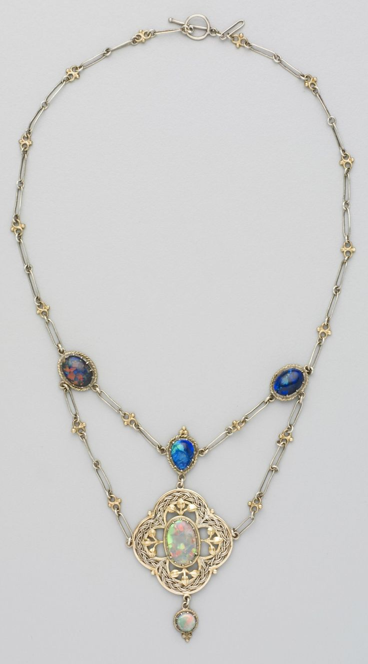 James W R Linton - An Arts and Crafts silver, gold and opal necklace, Perth, Western Australia, circa 1918. A rare example of the work of jeweller and silversmith James W. R. Linton. Linton played an important role in the development of the decorative arts in Western Australia during his 30 years' teaching at the Perth Technical School. He introduced English Arts and Crafts ideals from his study of metalwork and enamelling at the Sir John Cass Technical Art School in London.