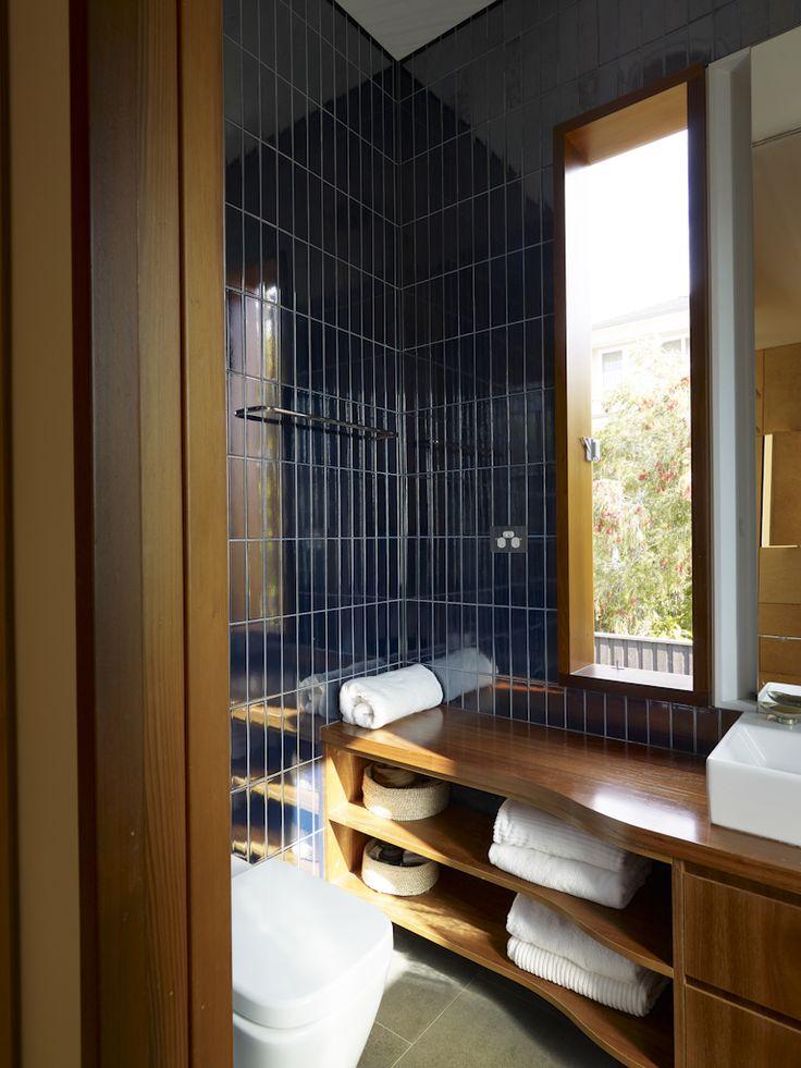 (c) Brett Boardman  Ensuite, Timber, Window, Bathroom, Blue Tiles, Architecture  http://www.samcrawfordarchitects.com.au/campbell-house-2/#