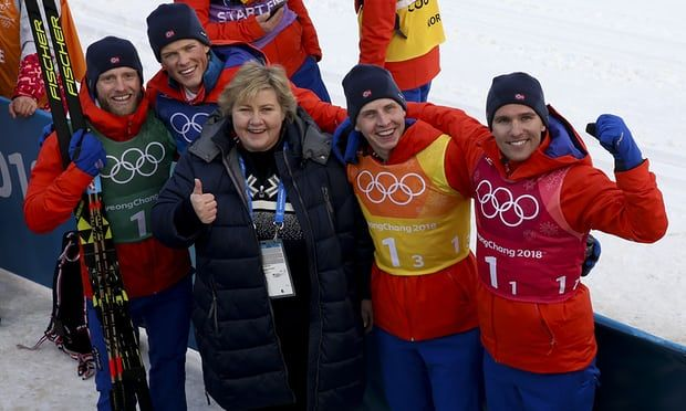 The prime minister, Erna Solberg, congratulates Norway's gold medallists in the men's 4x10km relay cross-country skiing in Pyeongchang. Photograph: Jean Catuffe/Getty Images