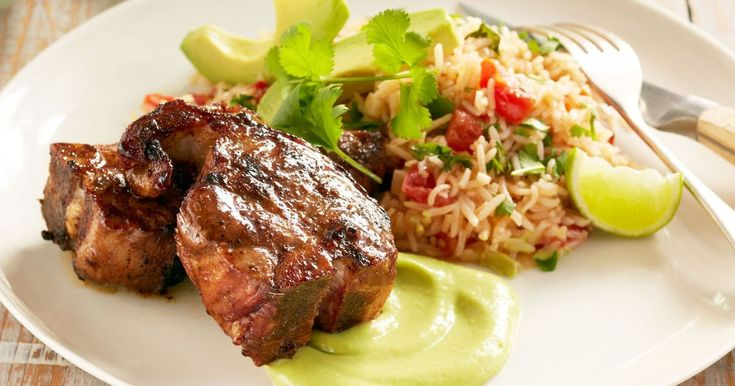 Feed your family with Curtis Stone's delicious grilled lamb loin chops with tomato and coriander rice and avocado sauce.