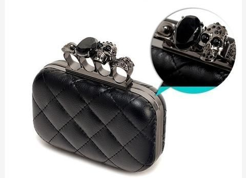This super stylish skull purse will allow you to carry all of your favorite treasures as you step out on the town. Featuring three diverse skulls and one bold black rhinestone, this beauty offers a ve