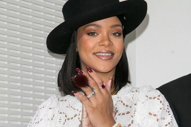 Rihanna Wears A Denim Skirt As A Top While Teasing Savage X Fenty When Yo Skirt Too Short Denim Skirt Rihanna Rihanna Photos