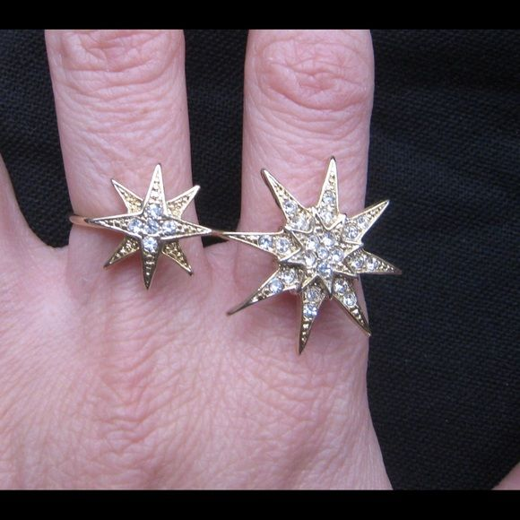 Very Pretty 2 Finger Ring Rhinestone Pave Starbust Double finger ring.  The ring has rhinestone pave with two starbursts - one larger than the other.  The ring itself is a gold color.  The ring is about a size 5, but because it made to fit over two rings, it's not snug as a true size five.  It measures 1.5 inches long.  The large starbust is very close to 1 inch H and W.  The smaller one is .25 inch H and W.  This is costume jewelry - it's not real gold nor real diamonds but very pretty…