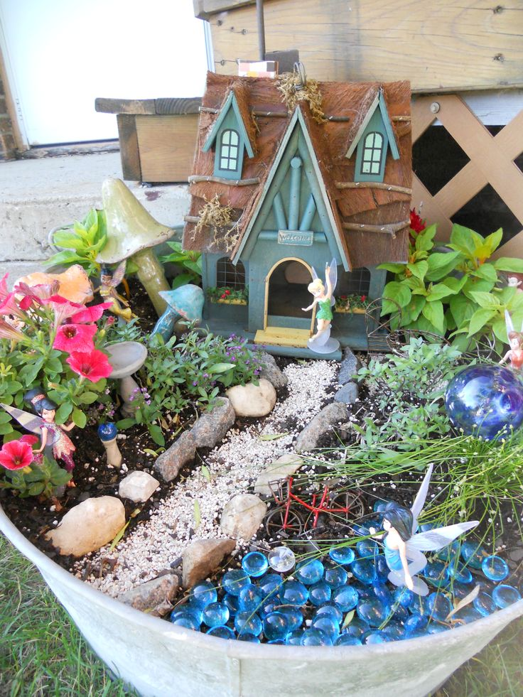 fairy garden. Blue pebbles for water! My shed is going to need multiple shelves…