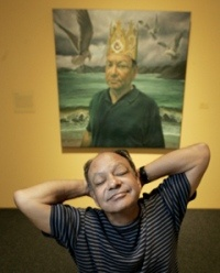 Cheech Marin poses with a likeness of himself by Eloy Torrez, one of some 50 art works by Latino artists that will be shown at the Los Angeles County Museum of Art.