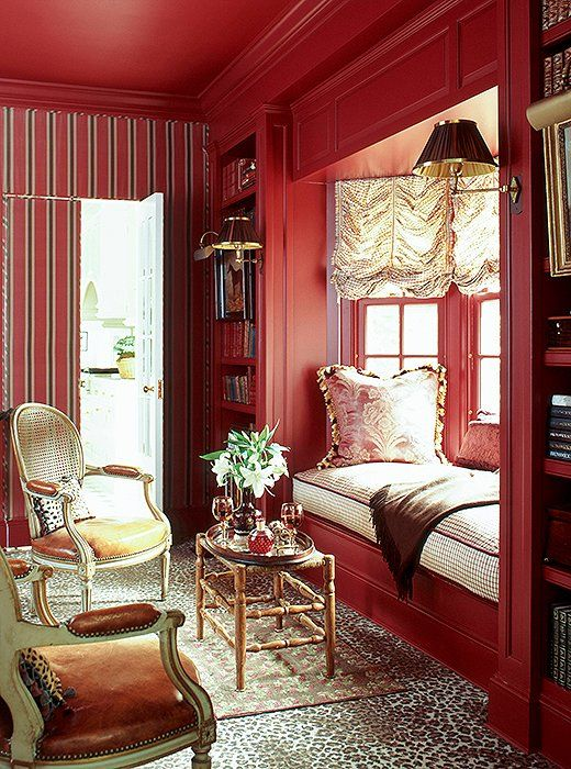 Love this all-red tea room with a built-in window seat and tons of romantic velvet and gold details!