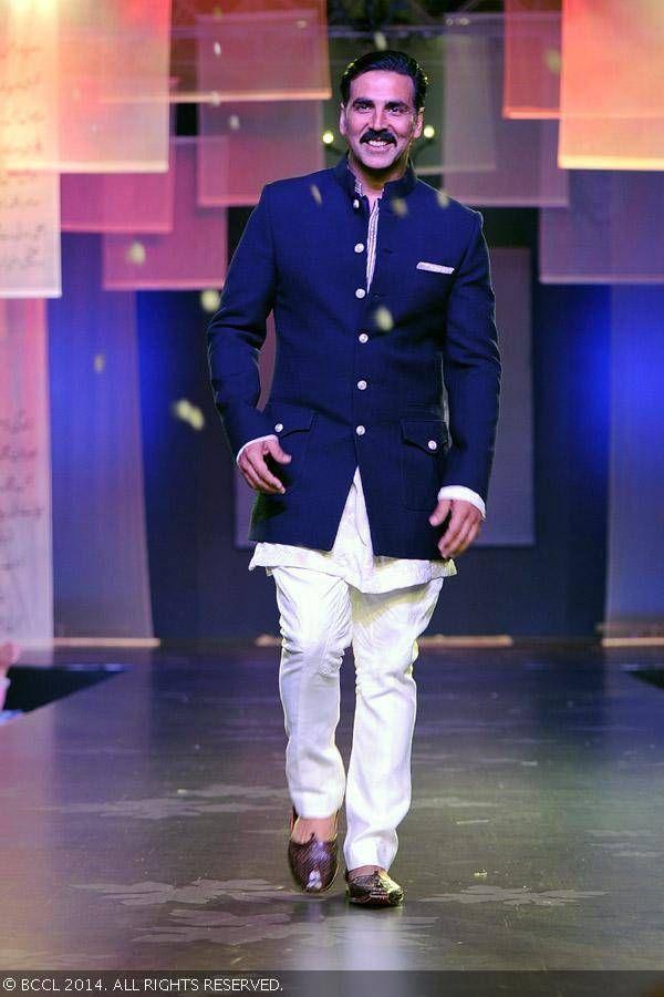 Akshay Kumar walks the ramp in designer Manish Malhotra's creation during Shabana Azmi's charity fundraising fashion show, 'Mijwan'