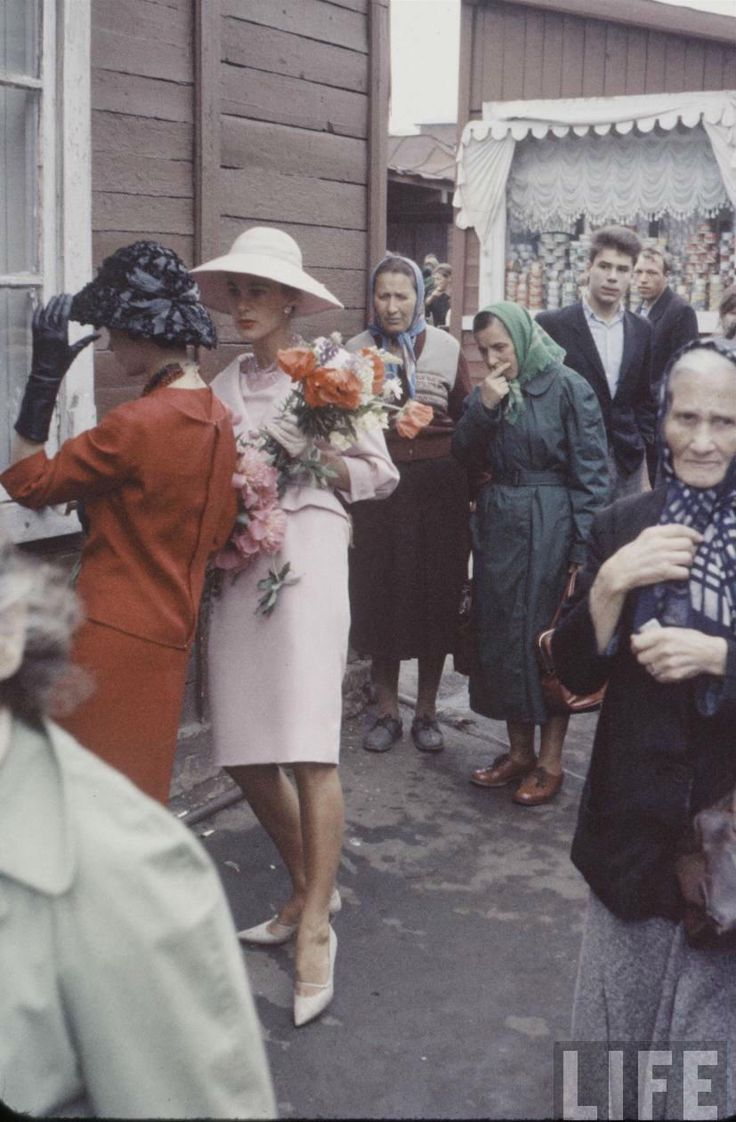 Christian Dior models walks through a Moscow market during a street fashion show when Soviet Russia first allowed foreign designers and stopped arresting people for trendy clothing. June 1959. Photo by Howard Sochurek.