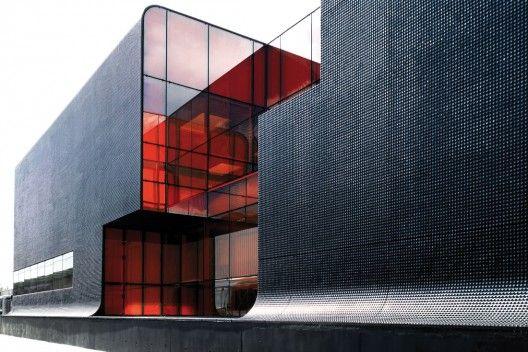 dark coloured glass windows modernist architecture black building