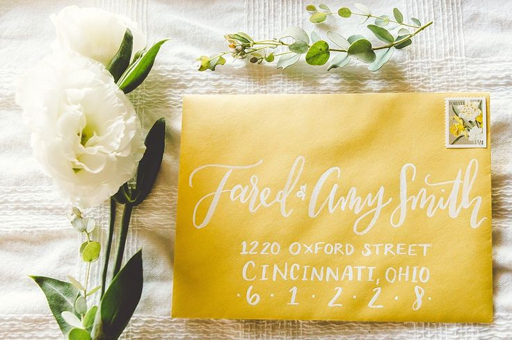 White calligraphy on a yellow envelope from Rising Tide Society Styled Shoot | @LetterLane | Modern Calligraphy, Addressing Envelopes, Wedding Calligraphy