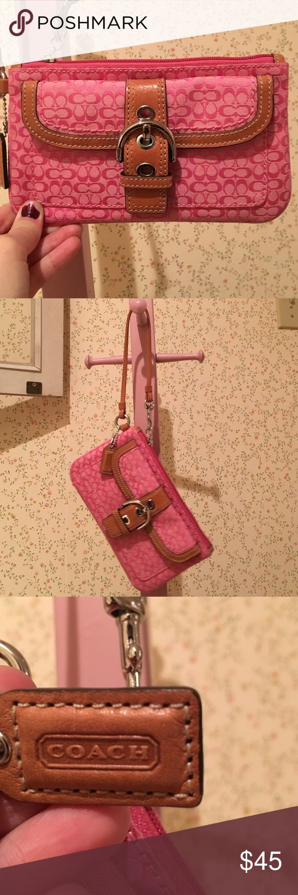 Coach pink wristlet bag Pink Coach wristlet in classic Coach pattern. Barely used, great condition. Coach Bags Clutches & Wristlets