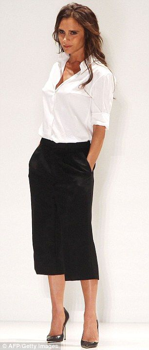 Keeping it simple in monochrome: Victoria wore a white shirt and black cropped trousers with heels