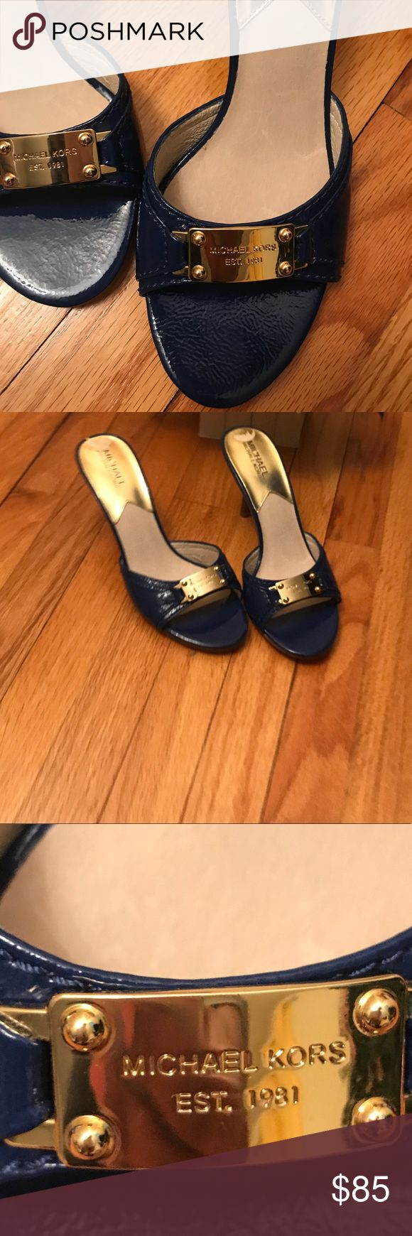 """Michael KORS: Deep Blue Gold Label Sandals Brand NEW.  These gorgeous slides are incredibly unique.  From their deep blue hue, to the gold MK bar on the foot strap, these are classy and sassy from heels to toes.  Pair with a flowy dress, skinny jeans or mini skirt.    The 3"""" heel makes them easy to slide on and slip off, and look fabulous while your feet feel fabulous too! Michael Kors Shoes Heels"""