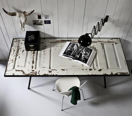 An old door upcycled into a desk for a rustic interior design look.  We made this with an old shutter and had glass custom made for the top. Very cool!