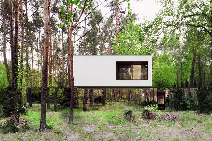 It's a modern, two-story home, defined by rectangular shapes, with a unique twist to its facade. The front and sides of the lower story are entirely clad in mirror-like panels, reflecting the woodland environment surrounding the house. Consequently, the second story appears to be floating in mid-air.