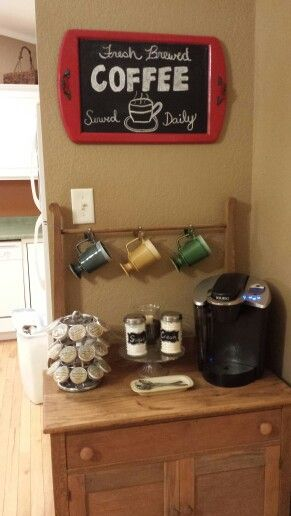 Antique wash stand re- purposed into a coffee bar. Spoons used to make the hooks..