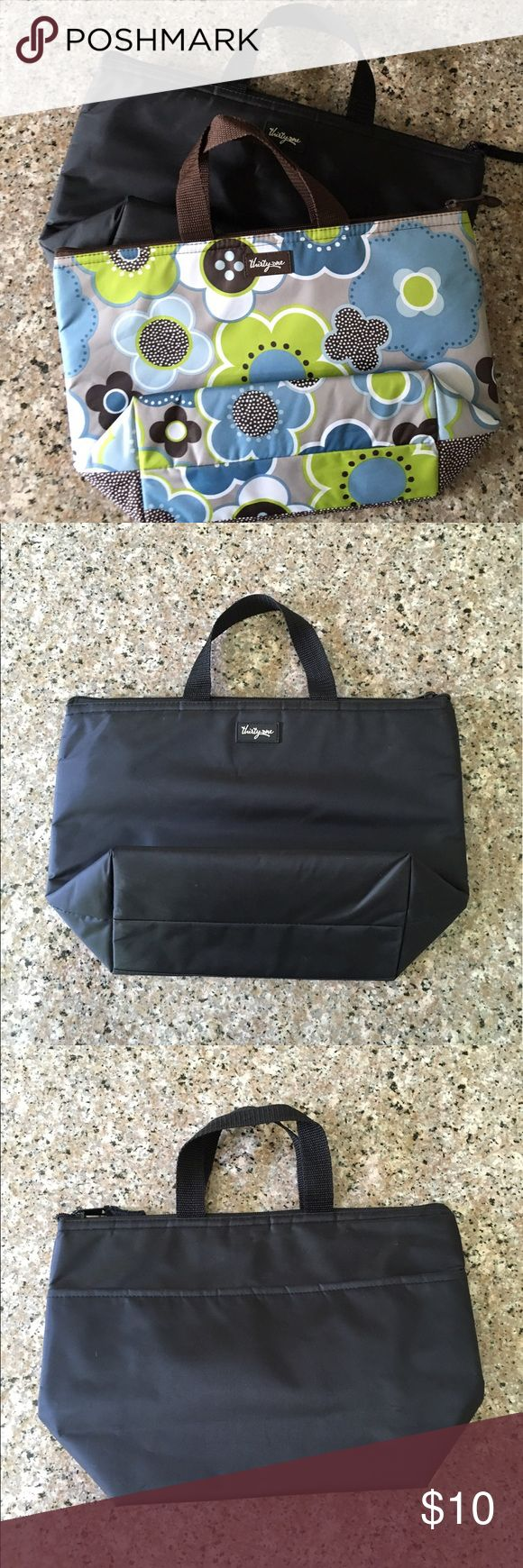 """Thirty-One Lunch Bag Set Thermal Lunch Bags. Zip-top closure. There is normal wear and tear as both of these bags have been used. In the interior of the floral dot thermal, there is a piece that is ripping. Item is New or Used: Used Size: 9"""" L x 4.5"""" W x 9.5"""" H Thirty-One Bags"""
