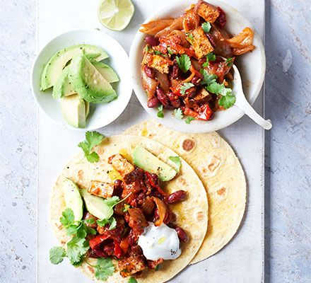 Smoked tofu adds protein to these vegetarian fajitas - pop on the table with corn or wheat wraps and watch them disappear