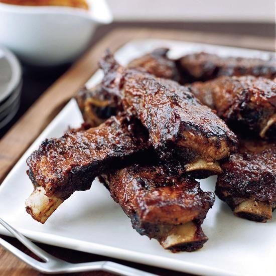 Sticky Barbecued Beef Ribs   These beef ribs—leftovers from the giant rib roast—are incredibly luscious. Chef Tim Love douses them in his sweet and tangy homemade barbecue sauce, then cooks them on the grill until they're crusty, sizzling and outrageously good.
