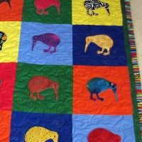 Quilt made using kiwi templates available from Carol's Quilts - note the great stripped border! #kiwi