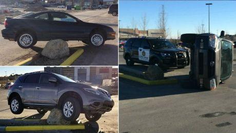 Drivers keep hitting large rock in suburban Calgary parking lot - Calgary - CBC News