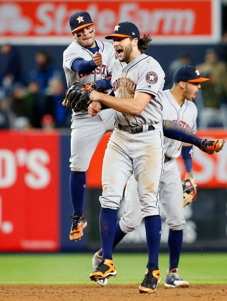 Carlos Correa Photos Photos - Jake Marisnick #6, Jose Altuve #27 and Carlos Correa #1 of the Houston Astros celebrate after defeating the New York Yankees at Yankee Stadium on May 11, 2017 in the Bronx borough of New York City. - Houston Astros v New York Yankees