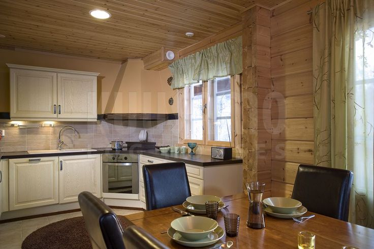 cocina casa de madera Kuusamo Log Houses modelo Tahko