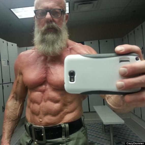 The impressively ripped abs, bulging biceps and defined pecs belong to a man with a weathered complexion, thick-rimmed glasses and Santa Claus-like beard. Description from zimgossips.blogspot.com. I searched for this on bing.com/images