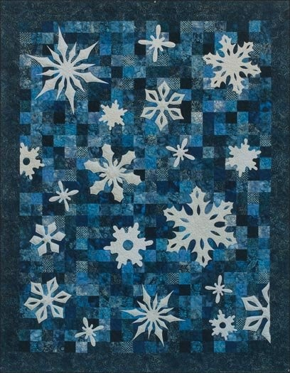 Snowflake Quilt. Navy and blue background with white applique stars.