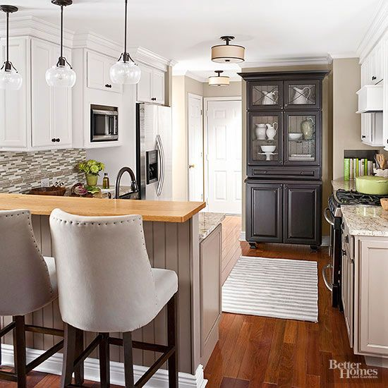 If your kitchen lacks built-in cabinetry, consider a stand-alone piece to increase the room's storage capacity. This freestanding armoire houses delicate dishware while lending warmth and charm in a transitional kitchen./
