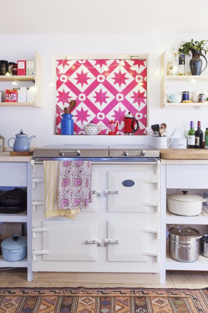 Got to love an Aga in an English country cottage. See textile designer Molly Mahon's beautiful Sussex cottage on Wear & Where.