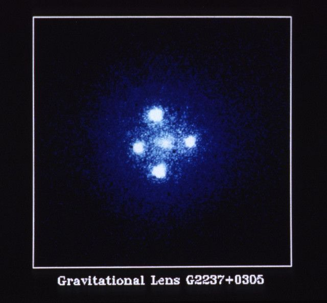 """An article published in """"The Astrophysical Journal Letters"""" describes a research on the quasar Q2237+0305 nicknamed Einstein Cross or Einstein's Cross. Through the technique of gravitational microlensing a team of Spanish astrophysicists carried out the most accurate measures of the innermost region belonging to the disc of materials spinning around the supermassive black hole that feeds this quasar. Read the details in the article!"""