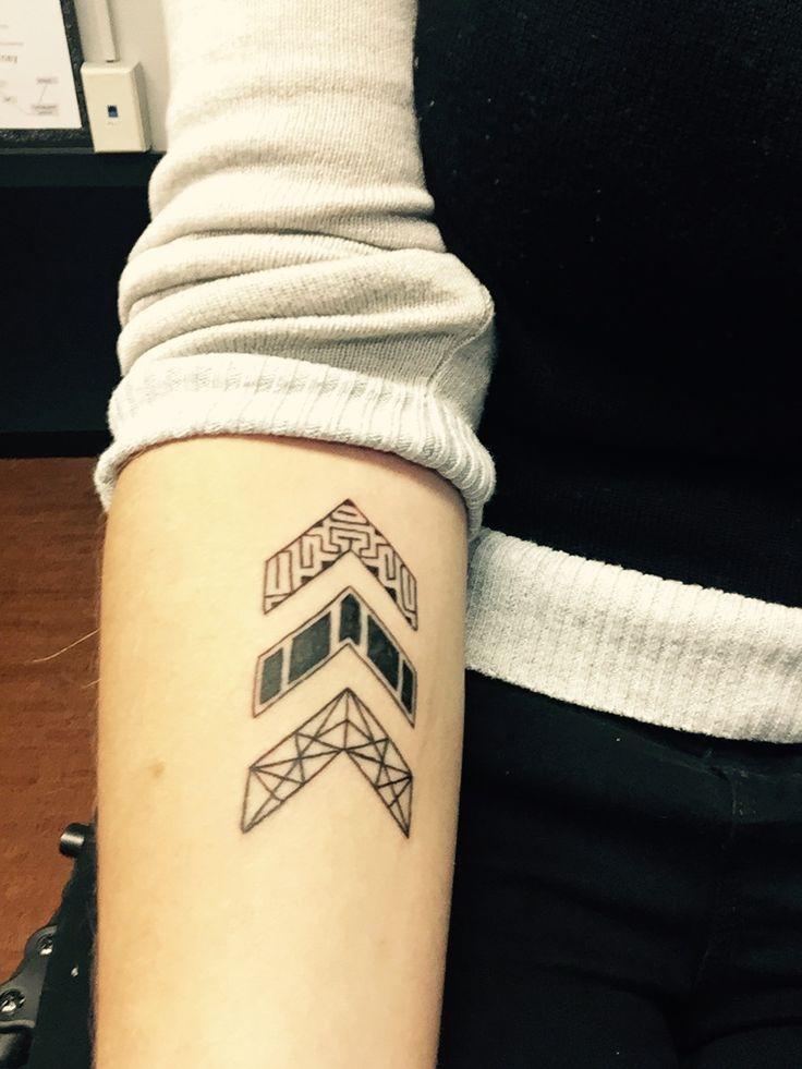 geometric design chevron tattoo on forearm