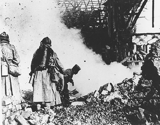 Flamethrowers and grenadiers mopping up German dugouts during the First Division attack at the Battle of Cantigny, May 28, 1918.