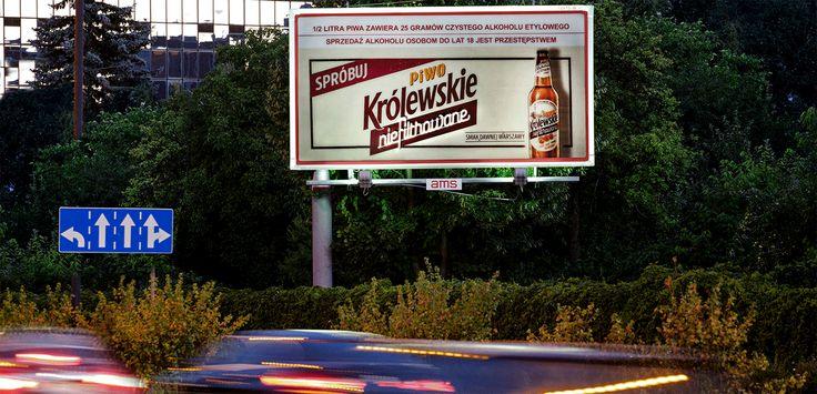 Piwo Królewskie niefiltrowane z podświetlonym napisem (Grupa Żywiec, lipiec 2016)