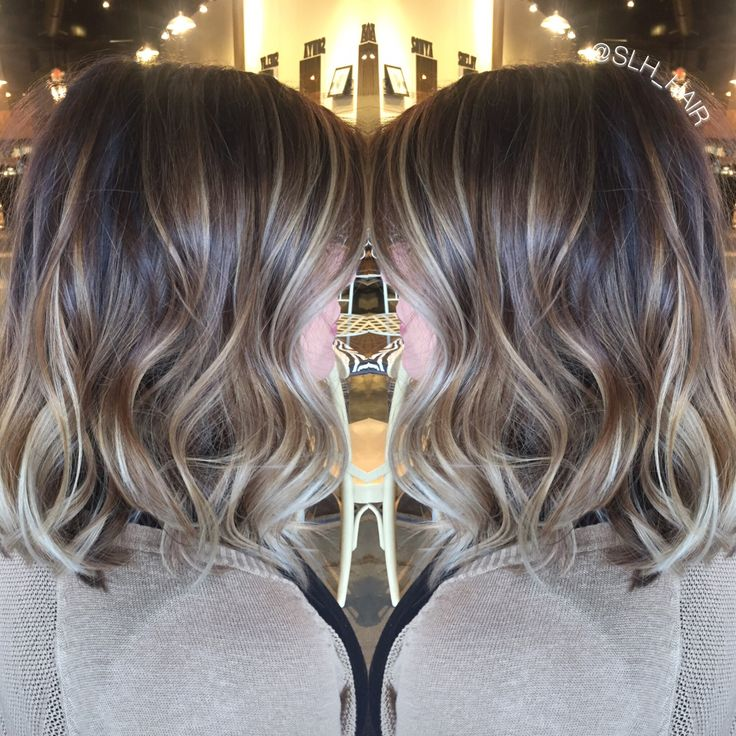Balayaged dimensional blonde. Brown root with cool toned highlights. Soft waves.