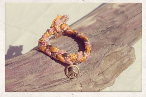 Braided bracelet with 14k gold plated peace charm!